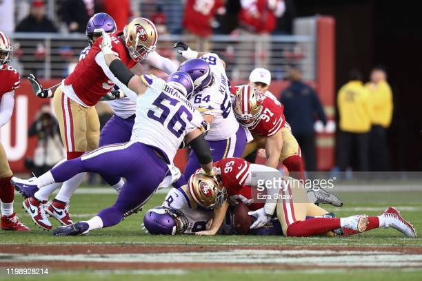 Kirk Cousins of the Minnesota Vikings is sacked by DeForest Buckner of the San Francisco 49ers during the second half of the NFC Divisional Round...