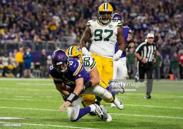 Kirk Cousins of the Minnesota Vikings is tackled with the ball by Blake Martinez of the Green Bay Packers third quarter of the game at US Bank...