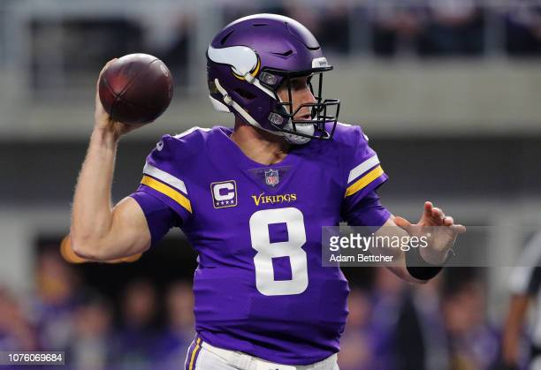 Kirk Cousins of the Minnesota Vikings looks for an open receiver in the first half against the Chicago Bears at US Bank Stadium on December 30 2018...