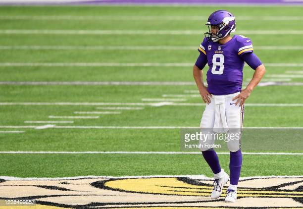 Kirk Cousins of the Minnesota Vikings looks on during the second quarter of the game against the Green Bay Packers at U.S. Bank Stadium on September...
