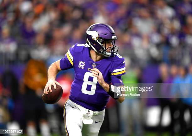 Kirk Cousins of the Minnesota Vikings looks to pass the ball in the first quarter of the game against the Chicago Bears at US Bank Stadium on...