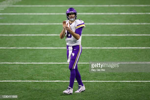 Kirk Cousins of the Minnesota Vikings looks up at the scoreboard in the fourth quarter against the Detroit Lions at Ford Field on January 3, 2021 in...