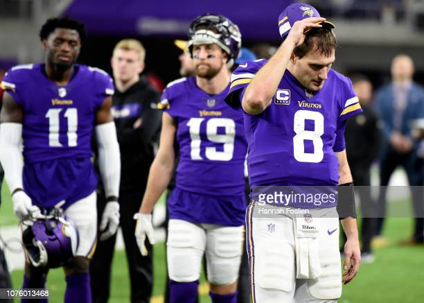 Kirk Cousins of the Minnesota Vikings on the sideline in the fourth quarter of the game against the Chicago Bears at US Bank Stadium on December 30...