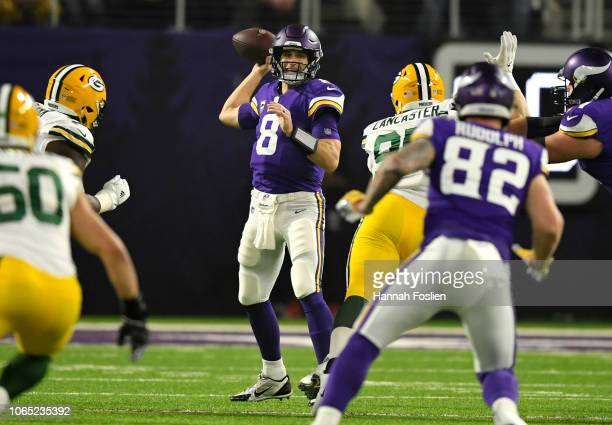 Kirk Cousins of the Minnesota Vikings passes the ball in the first quarter of the game against the Green Bay Packers at US Bank Stadium on November...