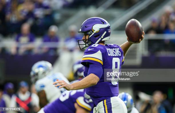 Kirk Cousins of the Minnesota Vikings passes the ball in the first quarter of the game against the Detroit Lions at US Bank Stadium on December 8...