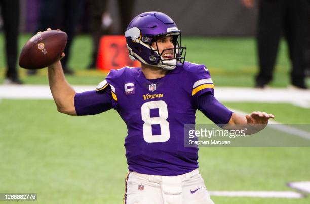 Kirk Cousins of the Minnesota Vikings passes the ball in the fourth quarter of the game against the Carolina Panthers at U.S. Bank Stadium on...