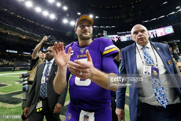 Kirk Cousins of the Minnesota Vikings reacts after defeating the New Orleans Saints 26-20 in the NFC Wild Card Playoff game at Mercedes Benz...