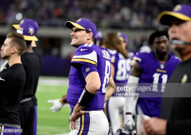 Kirk Cousins of the Minnesota Vikings reacts on the sideline in the fourth quarter of the game against the Chicago Bears at US Bank Stadium on...
