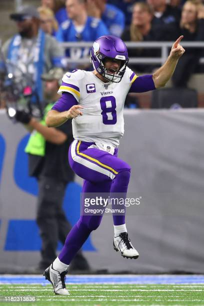 Kirk Cousins of the Minnesota Vikings reacts to a late fourth quarter touchdown run by Dalvin Cook to seal the game against the Detroit Lions at Ford...