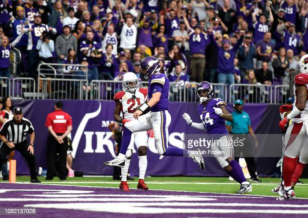 Kirk Cousins of the Minnesota Vikings runs into the end zone with the ball for a touchdown in the third quarter of the game against the Arizona...