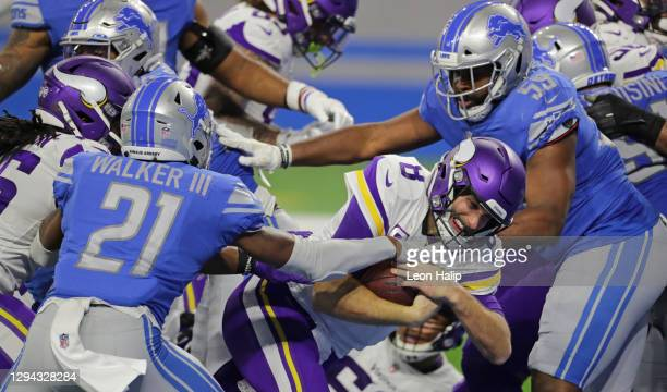 Kirk Cousins of the Minnesota Vikings scores a fourth-quarter touchdown during the game against the Detroit Lions at Ford Field on January 03, 2021...