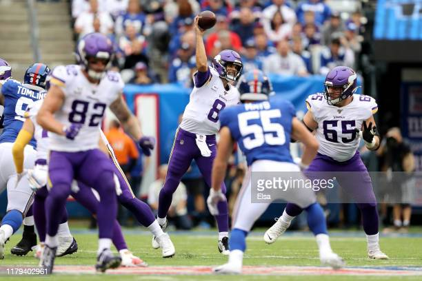 Kirk Cousins of the Minnesota Vikings throws a pass against the New York Giants during the first quarter in the game at MetLife Stadium on October 06...