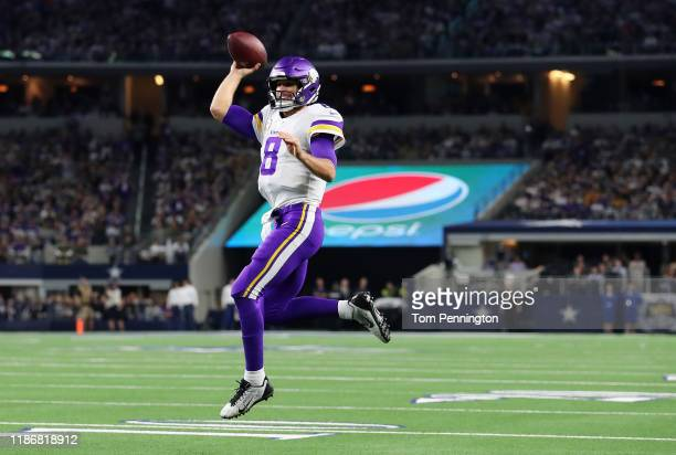 Kirk Cousins of the Minnesota Vikings throws a touchdown pass to Kyle Rudolph during the first quarter against the Dallas Cowboys at ATT Stadium on...