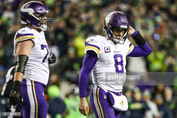 Kirk Cousins of the Minnesota Vikings walks off the field after an incomplete pass on 4th down in the fourth quarter against the Seattle Seahawks at...