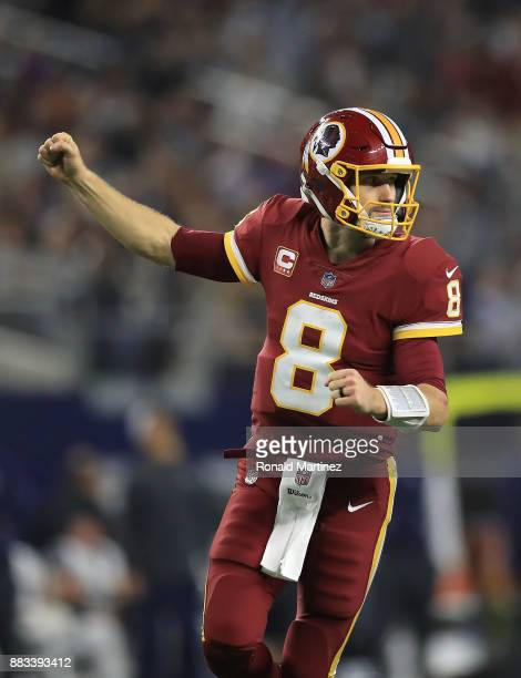 Kirk Cousins of the Washington Redskins celebrates after a third quarter touchown against the Dallas Cowboys at ATT Stadium on November 30 2017 in...