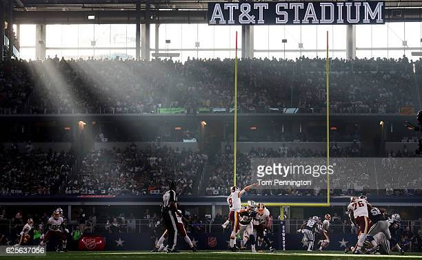 Kirk Cousins of the Washington Redskins completes a pass against the Dallas Cowboys in the second quarter at AT&T Stadium on November 24, 2016 in...