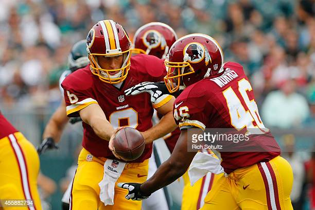 Kirk Cousins of the Washington Redskins hands off the ball to teammate Alfred Morris in the first half of the game against the Philadelphia Eagles at...