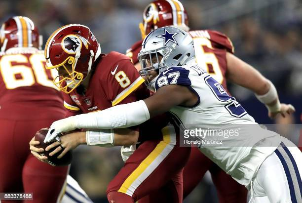 Kirk Cousins of the Washington Redskins is sacked by Taco Charlton of the Dallas Cowboys in the second quarter at ATT Stadium on November 30 2017 in...