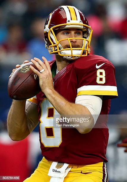 Kirk Cousins of the Washington Redskins looks for an open receiver against the Dallas Cowboys during the first quarter at ATT Stadium on January 3...