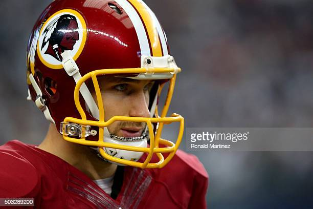 Kirk Cousins of the Washington Redskins looks on before the Redskins take on the Dallas Cowboys at ATT Stadium on January 3 2016 in Arlington Texas