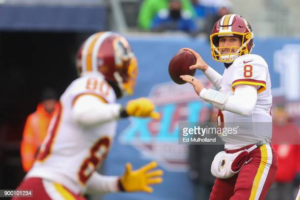 Kirk Cousins of the Washington Redskins looks to throw a pass during the first half of their game against the New York Giants at MetLife Stadium on...