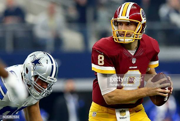 Kirk Cousins of the Washington Redskins looks to throw against Tyrone Crawford of the Dallas Cowboys during the first half at ATT Stadium on January...