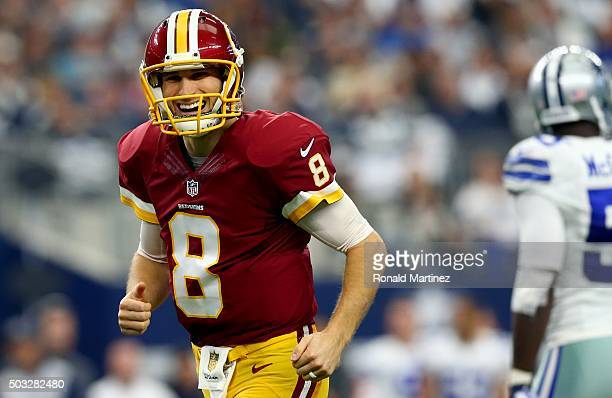 Kirk Cousins of the Washington Redskins reacts after throwing a touchdown pass against the Dallas Cowboys during the first quarter at ATT Stadium on...