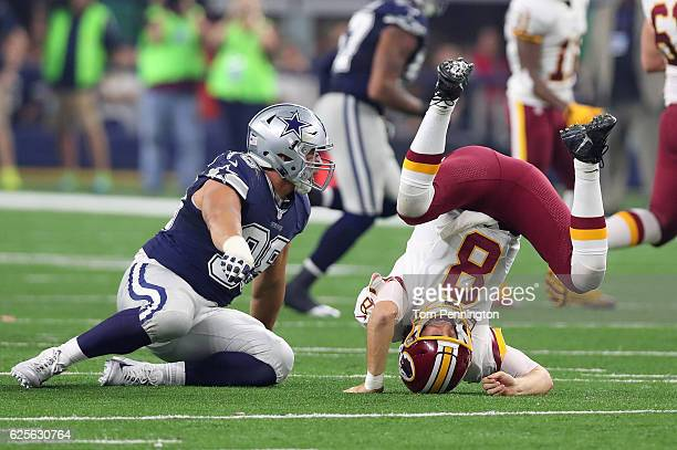 Kirk Cousins of the Washington Redskins takes a hit from Tyrone Crawford of the Dallas Cowboys during the second quarter of their game at ATT Stadium...