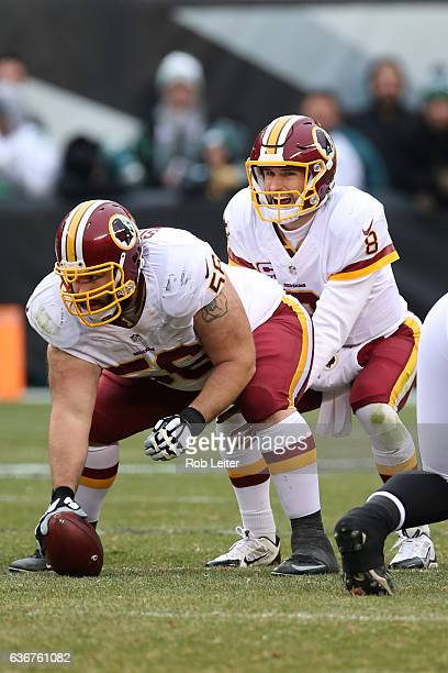 Kirk Cousins of the Washington Redskins takes the snap from John Sullivan during the game against the Philadelphia Eagles at Lincoln Financial Field...