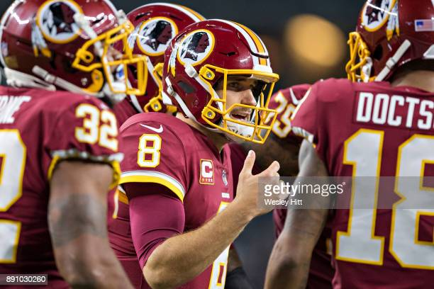 Kirk Cousins of the Washington Redskins talks in the huddle during a game against the Dallas Cowboys at ATT Stadium on November 30 2017 in Arlington...