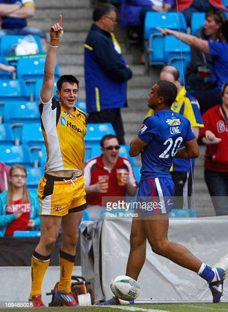 Kirk Dixon of Castleford celebrates after scoring a try during the Super League Magic Weekend match between Castleford Tigers and Wakefield Wildcats...