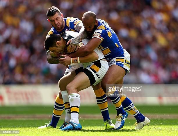 Kirk Dixon of Castleford is tackled by Brett Delaney and Jamie JonesBuchanan of Leeds during the Tetley's Challenge Cup Final between Leeds Rhinos...