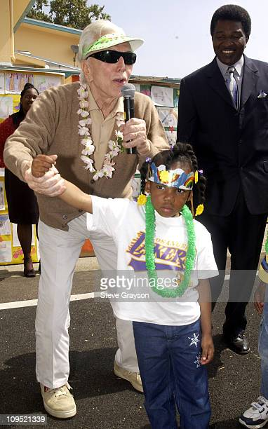 Kirk Douglas addresses students at LaSalle Avenue School in SouthCentral Los Angeles during the dedication of a playground and equipment donated on...