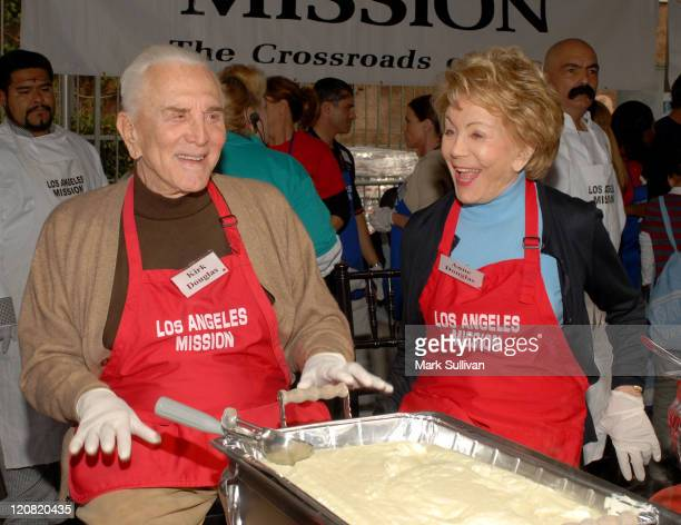 Kirk Douglas and Anne Douglas during Thanksgiving for the Homeless at The Los Angeles Mission at Los Angeles Mission in Los Angeles California United...