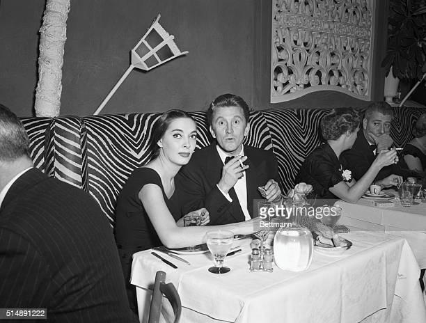 Kirk Douglas and friend enjoying the El Morocco Nightclub 154 East 54th Street New York City