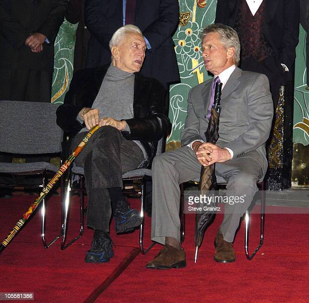 Kirk Douglas and Michael Douglas during Jack Valenti Dedication with Hand and Footprints at Grauman's Chinese Theatre at Grauman's Chinese Theatre...