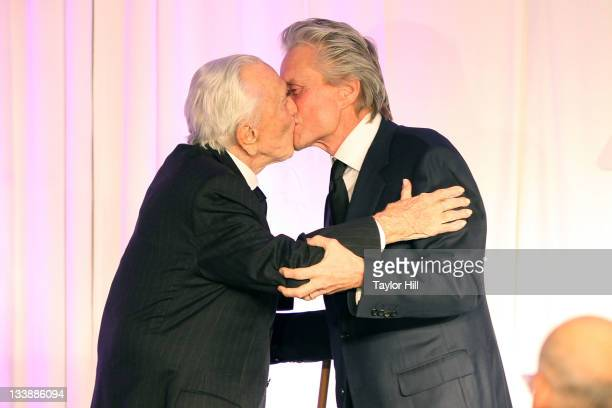 Kirk Douglas and Michael Douglas embrace at the 2011 Children of Chernobyl's Children at Heart gala at the Chelsea Piers on November 21 2011 in New...