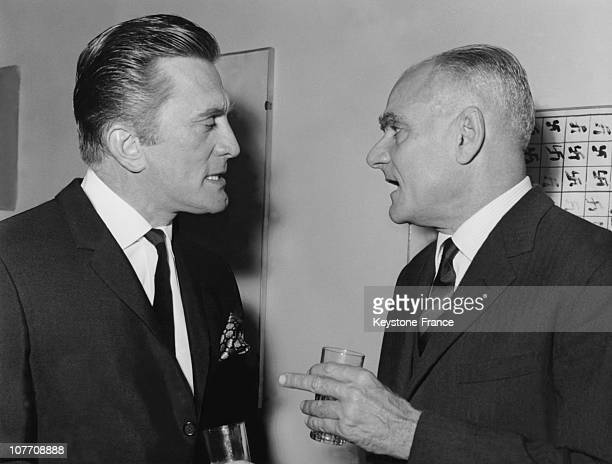 Kirk Douglas And The Italian Writer Alberto Moravia At A Cocktail Party Given In Honor Of American Actor On February 28Th 1964
