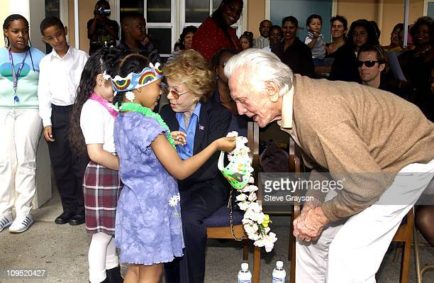 Kirk Douglas and wife Anne are presented visors and flowers by students at LaSalle Avenue School in SouthCentral Los Angeles during the dedication of...