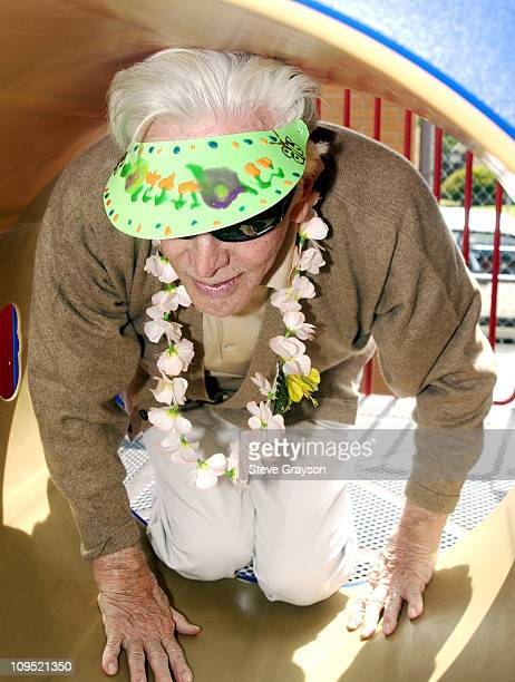 Kirk Douglas at LaSalle Avenue School in SouthCentral Los Angeles crawls through a playground tunnel during the dedication of playground equipment...