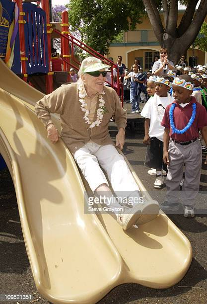 Kirk Douglas at LaSalle Avenue School in SouthCentral Los Angeles makes a test run on the slides and chutes during the dedication of playground...