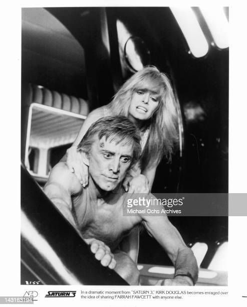 Kirk Douglas becomes enraged over sharing Farrah Fawcett with anyone else in a scene from the film 'Saturn 3' 1980 Photo by Associated Film...