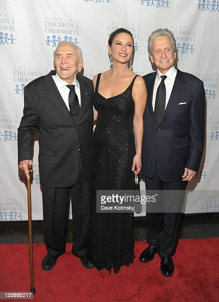 Kirk Douglas Catherine ZetaJones and Michael Douglas attend the 2011 Children of Chernobyl's Children at Heart gala at the Chelsea Piers on November...