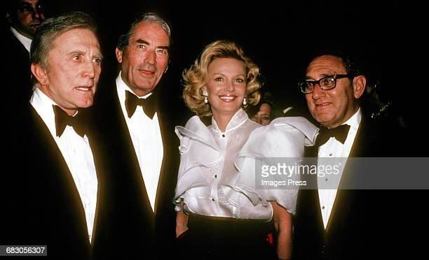 Kirk Douglas Gregory Peck Barbara Sinatra and Henry Kissinger circa 1980 in New York City