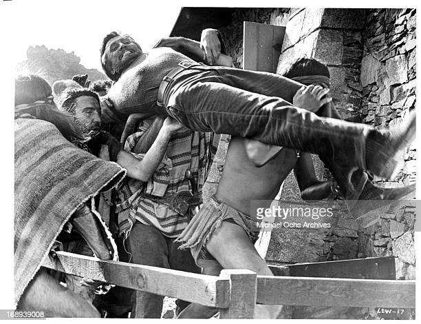 Kirk Douglas is captured by a group of pirates in a scene from the film 'The Light At The Edge Of The World' 1971