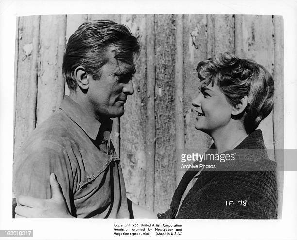 Kirk Douglas looks to Diana Douglas in a scene from the film 'The Indian Fighter' 1955