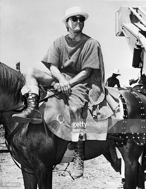 Kirk Douglas on horseback wearing a straw hat and sunglasses between takes on the set of Sparticus the epic of a Roman slave rebellion