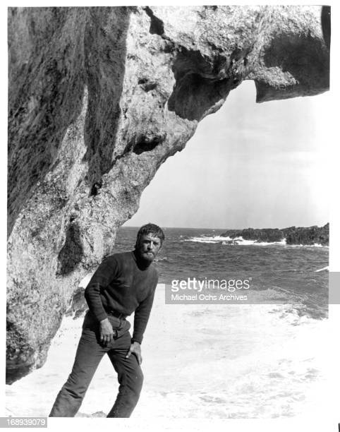 Kirk Douglas on the beach in a scene from the film 'The Light At The Edge Of The World' 1971