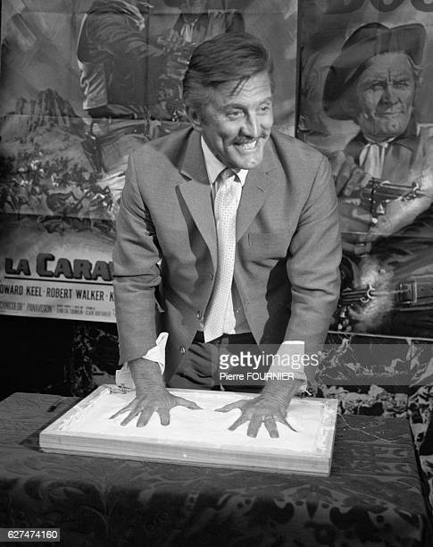Kirk Douglas promotes the 1967 American movie The Way West in Paris' Grand Rex theater