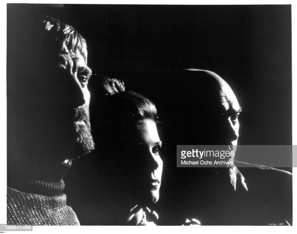 Kirk Douglas Samantha Eggar and Yul Brynner in publicity portrait for the film 'The Light At The Edge Of The World' 1971